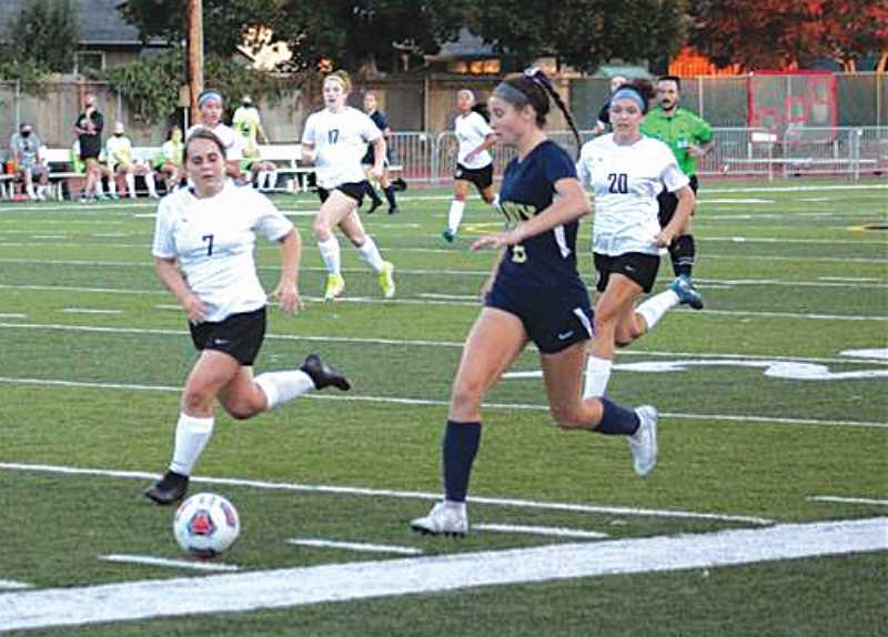 PMG PHOTO: KRISTEN WOHLERS - Ashley Peterson takes the ball up the sideline. Canby High girls earned a 1-1 tie with Nelson on Sept. 8.