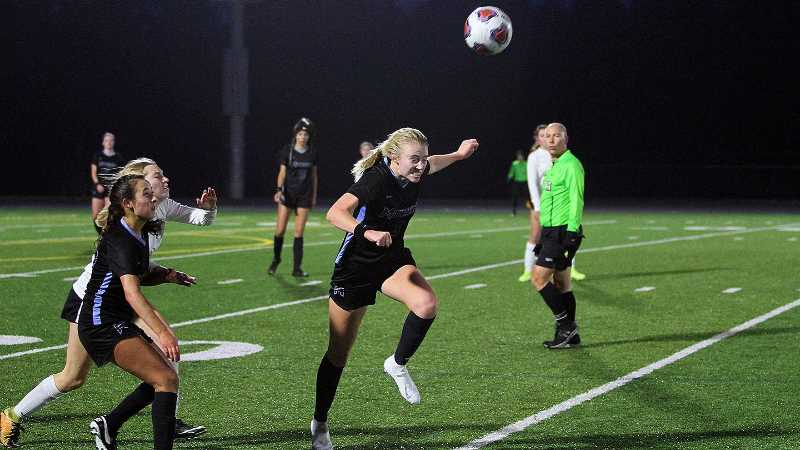 PMG PHOTO - Mountainside's Stella Bauman makes a running header during her teams win over West Linn in the Class 6A state quarterfinals in 2019. Bauman was one of a number of key Mountainside girls players lost to graduation, and who will need to replaced this year for the Mavericks to continue their run of success.