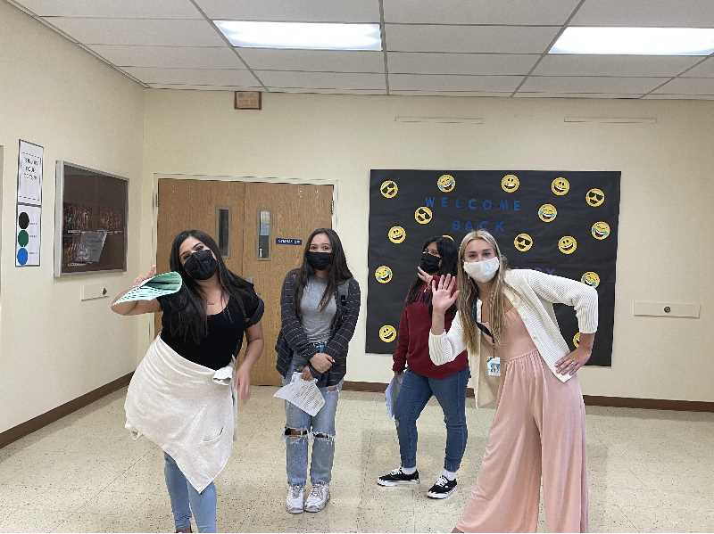 COURTESY PHOTO,TAMI BADINGER - First Day: Three Middle School students (Leslie Aguilar Martinez, Leslie Aguilar Martinez, Daneika Hobin, and Emily Emma Rodriguez Rojas, and Emily Emma Rodriguez Rojas) enjoy a fun moment with Kara Handran (right), who teaches seventh-grade math.