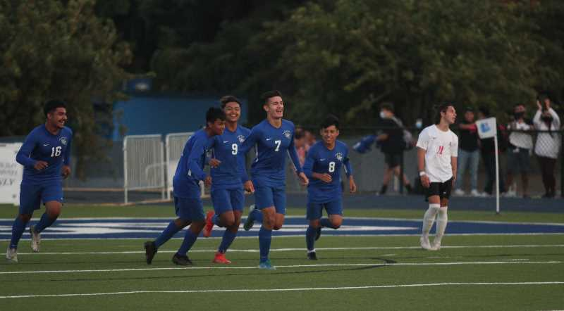 PMG PHOTO: TANNER RUSS - Junior Spencer Karsseboom celebrates scoring his first of two goals with his team. Woodburn would go on to win 3-0 against Clackamas on Thursday, Sept. 9.