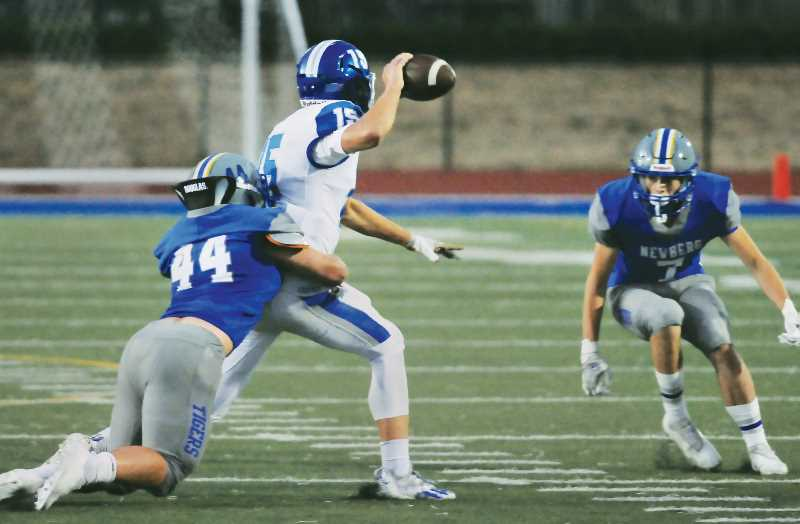 PMG PHOTO: GARY ALLEN - Newberg's defense stymied the Celtics for much of the game Friday at home.
