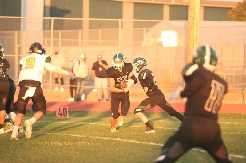 PMG PHOTO: TANNER RUSS - North Marion running back Marcus Ledesma was a consistent source of energy for the Huskies as they struggled against the Sweet Home Huskies on Sept. 10.
