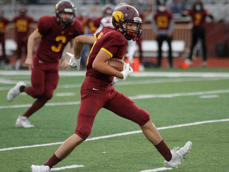 PMG PHOTO: WADE EVANSON - Forest Grove receiver Michael Yakos runs after a catch during the first quarter of the Vikings' 24-21 win over McMinnville Friday night, Sept. 10, at Forest Grove High School.