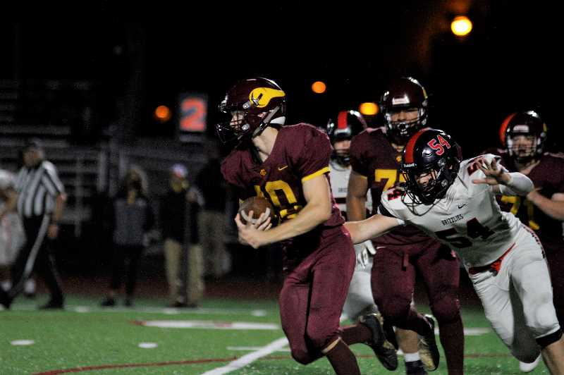 PMG PHOTO: WADE EVANSON - Forest Grove running back David Johnson carries the ball during the Vikings' 24-21 win over McMinnville Friday night, Sept. 10, at Forest Grove High School. Johnson had a 65 yard interception for a touchdown in the game.