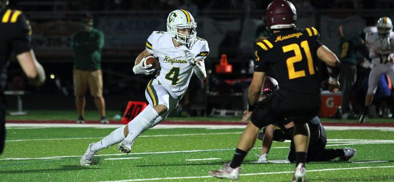PMG PHOTO: MILES VANCE - Putnam sophomore wide receiver Tyler Creswick races upfield during his team's 23-21 win over Milwaukie at Milwaukie High School on Friday, Sept. 10.