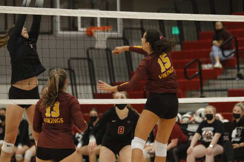 PMG PHOTO: WADE EVANSON - Forest Grove's Valentina Raggi (15) rises for a spike during their match Sept. 9 at Sherwood High School.