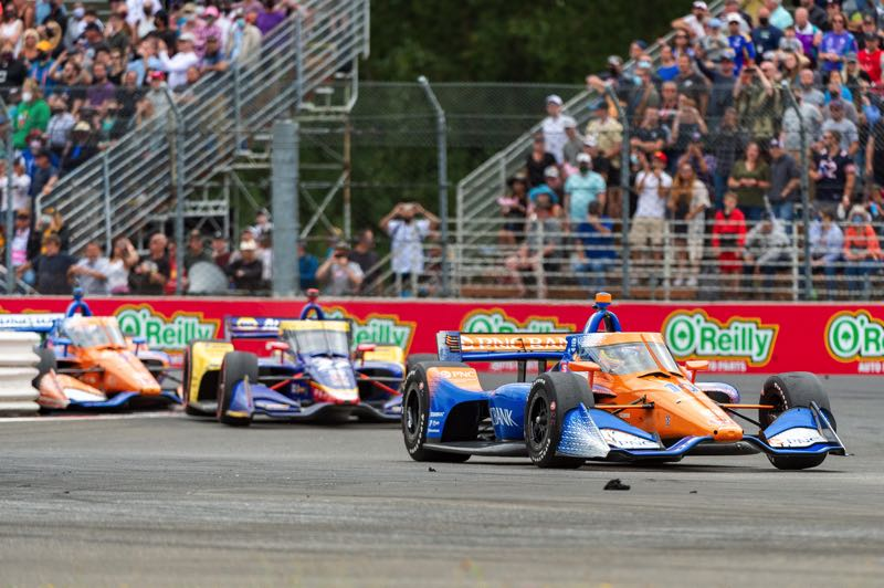 PMG PHOTO: DIEGO G. DIAZ - Alex Palou leads Alexander Rossi and Scott Dixon in the late stages of the Grand Prix of Portland. Palou was the top qualifier and then managed, thanks to his team, to get through cautions and competition to win and retake the IndyCar Series points lead.