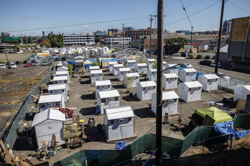 PMG PHOTO: JONATHAN HOUSE - An uncertain future looms for the outdoor homeless villages on Portland's east side, as the city's development commission says the land is promised to a builder of industrial offices.