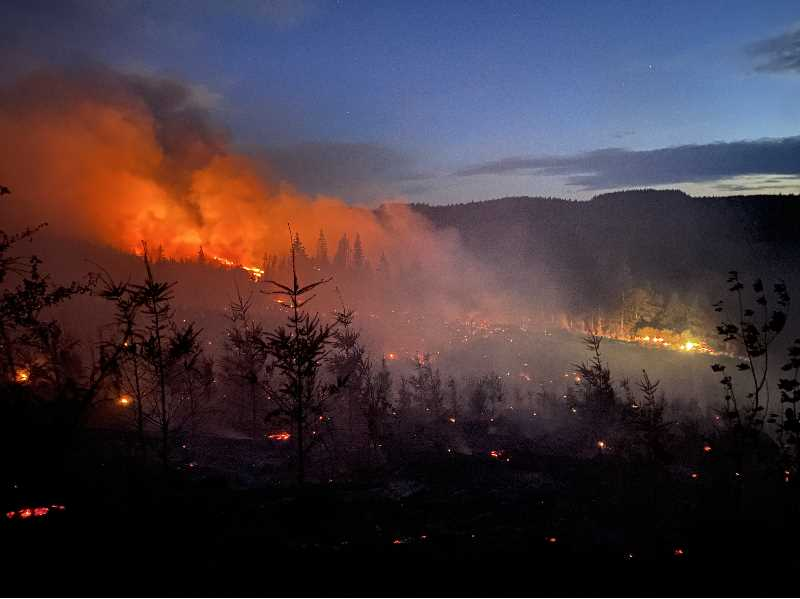 COURTESY PHOTO: SCAPPOOSE FIRE DISTRICT - Photos shared by the Scappoose Fire show the Alder Creek fire on the night of Saturday, Sept. 11.