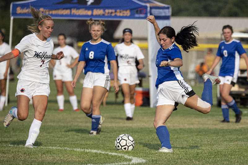 LON AUSTIN - Lauren Papke prepares to rip a kick during the Cowgirls' 8-0 loss to Caldera, the new high school in Bend. The Cowgirls kept the game close in the first half, but the Wolfpack dominated half two.