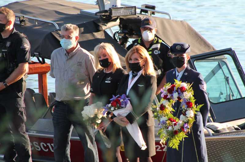 PMG PHOTO: HOLLY BARTHOLOMEW - Several honorees stand on the dock at the West Linn Honoring Those Who Serve ceremony.