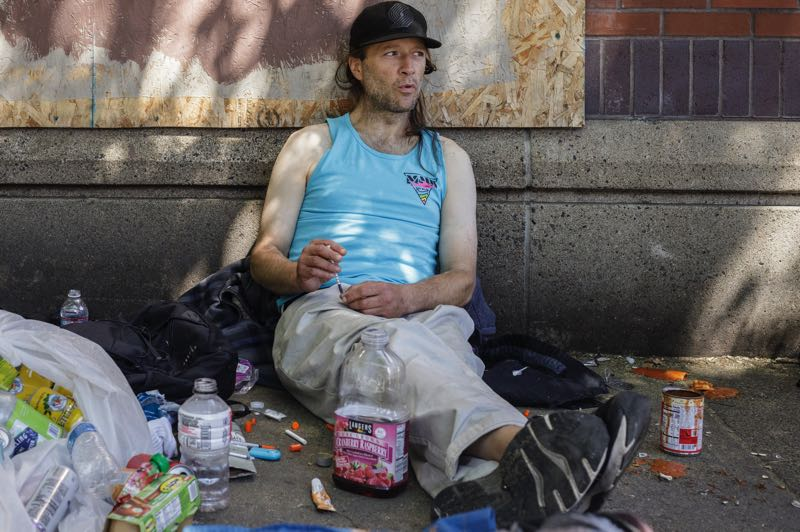PMG PHOTO: JONATHAN HOUSE - Mike Evans leans against the wall of the former Portland Greyhound Bus Station, which is now used as a homeless shelter.