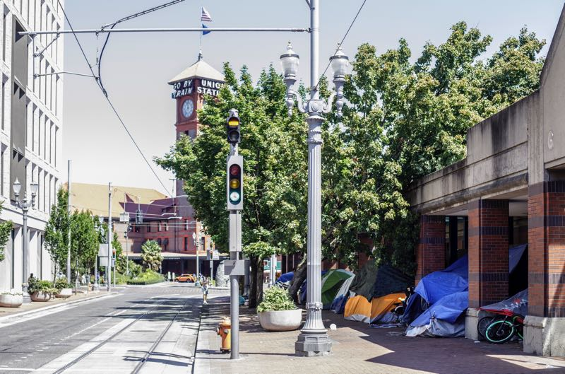 PMG PHOTO: JONATHAN HOUSE - Just blocks from Union Station, people are camping on the perimeter of the former Greyhouse Bus Station, which has been converted into a homeless shelter.