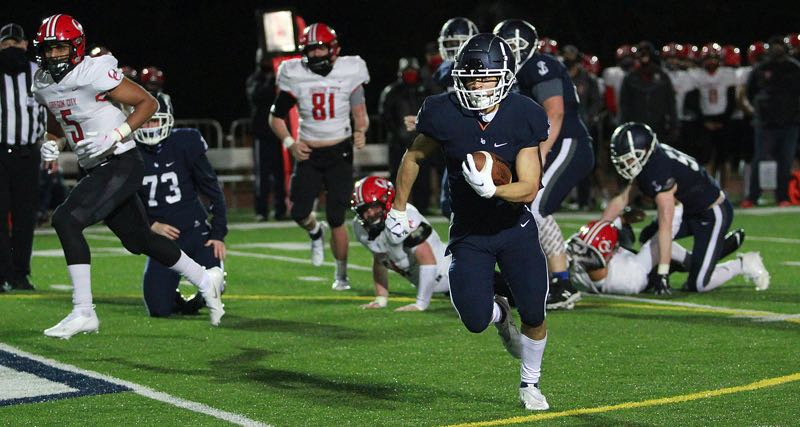 PMG PHOTO: MILES VANCE - Lake Oswego senior running back Gabe Olvera is ready for a big year after leading the Lakers through their pandemic-shortened campaign last spring.