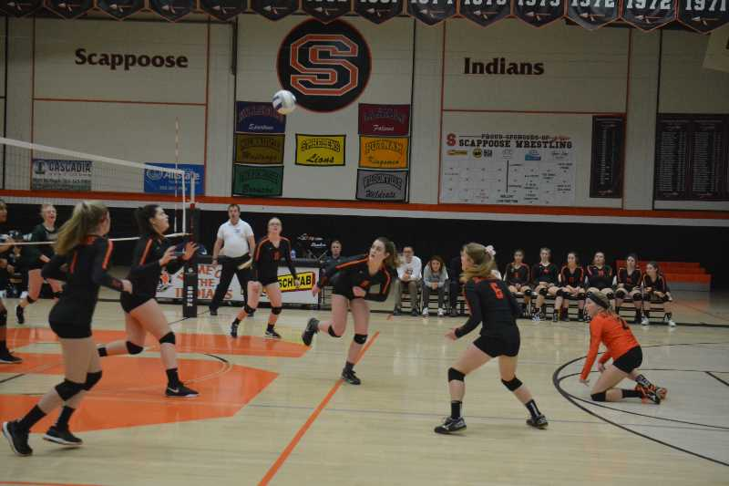 PMG PHOTO: STEVE BRANDON - Scappoose players battle to keep the ball alive during their final game of the 2019 season. Two players pictured — Abby Stansbury and Raleigh Erickson — are now beginning their junior year season.