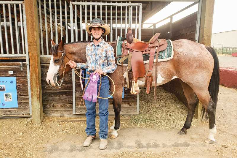 PHOTO SUBMITTED BY BRIANA SUTHERLIN  - Tristan Sutherlin with his horse, Minx. The State Fair was his first year in intermediate and first time as a state qualifier in the equestrian division. He was one of the youths to qualify for Ranch Horse State Fair, in addition to Josie Lauman.