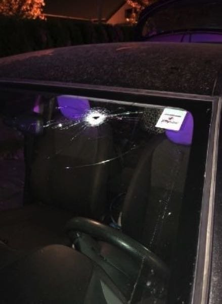 COURTESY PHOTO: KOIN 6 NEWS - The windshiled of the car hit by a bullet late Monday.