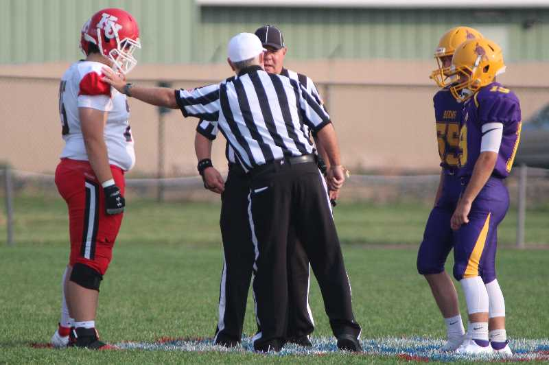 ANDY DIECKHOFF/MADRAS PIONEER - The Madras-Sisters game was able to go forward on Friday, but only because the same officiating crew agreed to work a doubleheader, which also included a matchup between Burns and Klamath Union.