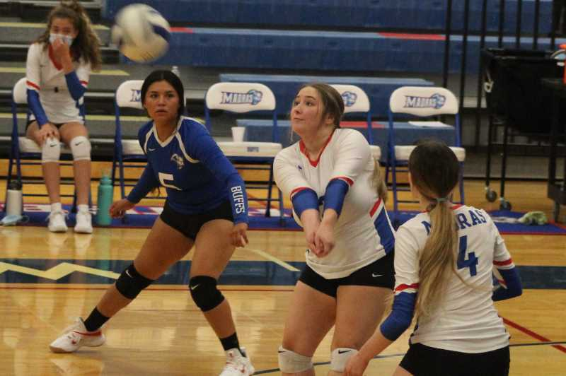 ANDY DIECKHOFF/MADRAS PIONEER - Senior setter Alexa La Pier, center, led the Buffs with four aces during Friday's home loss to Redmond.