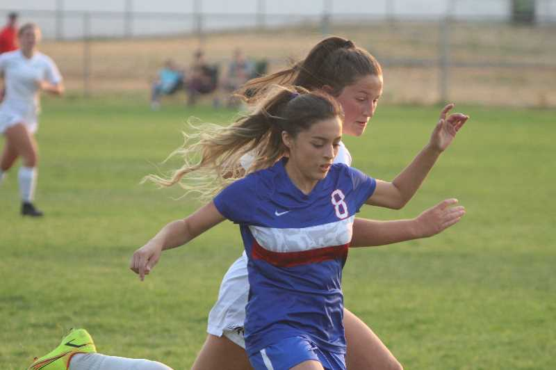 ANDY DIECKHOFF/MADRAS PIONEER - Diamond Amaya works her way down the right wing during last week's home match against Sisters.