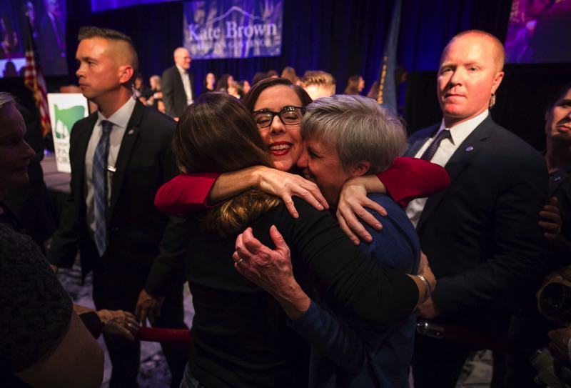 PMG FILE PHOTO - Gov. Kate Brown hugs supporters after winning reelection in 2018. Term limits prevent Brown from seeking another term.