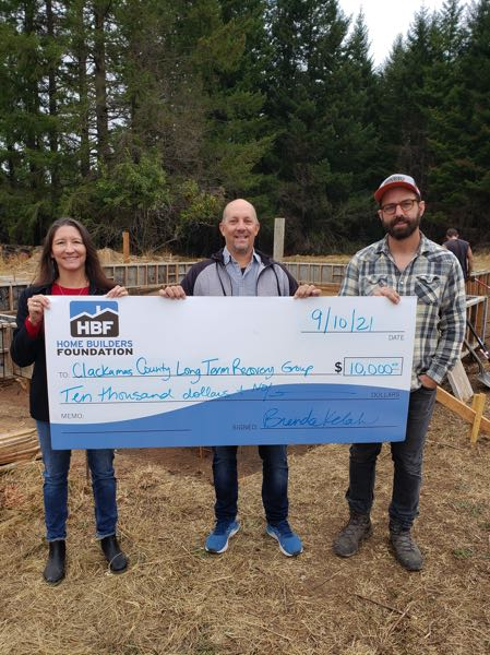 COURTESY PHOTO - The Home Builders Foundation presents a check to the Clackamas County Long Term Recovery Group.