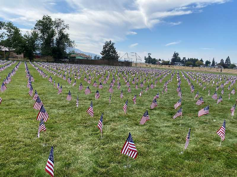 PHOTO COURTESY OF CINDY DIX  - Volunteers placed nearly 3,000 flags at Culver's Veterans Memorial Park Saturday, marking the 20th anniversary of the 9/11 terrorist attacks. Culver residents Cindy Dix and Rachel Bare spearheaded the project and several people donated money to buy the flags. With funds left over, Dix and Bare served pancakes to the crowd.