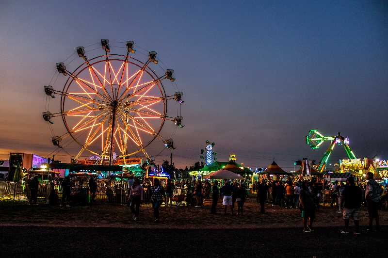 JENNIFFER GRANT/MADRAS PIONEER   - Carnival receipts more than doubled at the Jefferson County Fair and Rodeo this year. The vendor, Paul Mauer Shows, brought 20 rides rather than the usual 15, and replaced all incandescent bulbs with LEDs, creating a brilliant light show after dark.