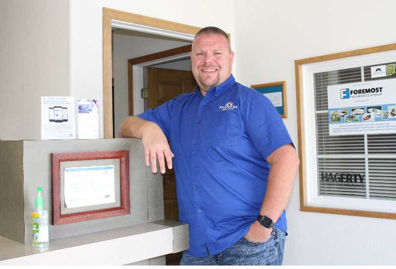 HOLLY SCHOLZ/MADRAS PIONEER - Travis Montgomery bought the Madras Farmers Insurance agency from Mike and Becky Goss. Montgomery will continue to offer a variety of insurance services from the same location.
