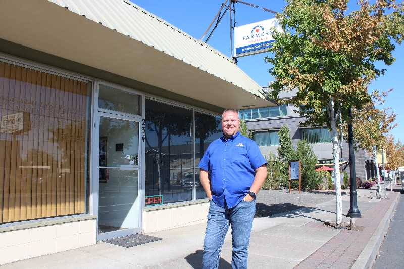 HOLLY SCHOLZ/MADRAS PIONEER  - Travis Montgomery has ordered new signage for the building on Southwest Fourth Street in downtown Madras.