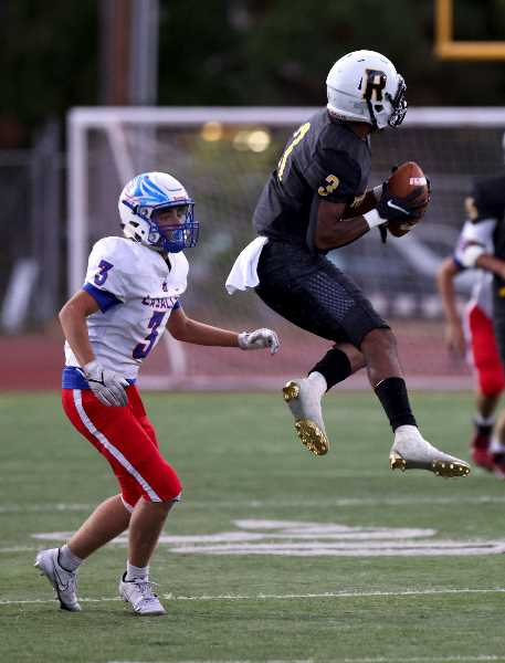 PHOTO BY JONATHAN HOUSE - Roosevelt football's Lindell Betts, right, grabs an interception against La Salle Prep on Friday, Sept. 10, 2021, at Roosevelt High School.