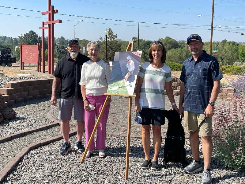 PHOTO COURTESY OF MADRAS UNITED METHODIST CHURCH  - Left to right, Jim, Edna, Kim and Allen Tangeman stand in the Arland Tangeman Memorial Garden and Labyrinth during a dedication ceremony at Madras United Methodist Church.