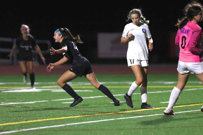 PHOTO BY JAIME VALDEZ-PAMPLIN MEDIA - Sherwood girls soccer's Ella Weathers (4) after scoring the Bowmen's first goal in the second half against Grant at Sherwood High School.