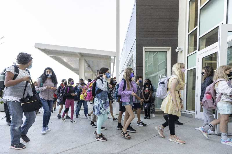PMG PHOTO: JONATHAN HOUSE - Students at Kellogg Middle School in Portland return to campus for the first day back on Dept. 1. Portland Public Schools is weighing whether to require all students 12 and older to be vaccinated to attend school.