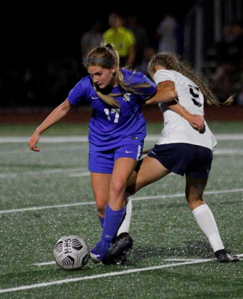PMG PHOTO: WADE EVANSON - Hillsboro junior midfielder Calee Barss fights for a ball during the Spartans 4-0 win over Hood River Valley Tuesday night, Sept. 14, at Hillsboro High School.
