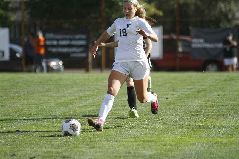PMG PHOTO: WADE EVANSON - Tigard freshman defender Kiera Grant chases down a ball during the Tigers' nonleague game at Scappoose Tuesday, Sept. 14, at Chinook Park in Scappoose.