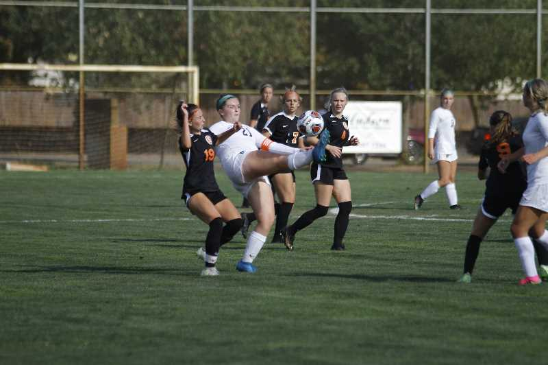 PMG PHOTO: WADE EVANSON - Tigard sophomore midfielder McKenna Eggleston controls the ball in the air during the Tigers' nonleague game at Scappoose Tuesday, Sept. 14, at Chinook Park in Scappoose.
