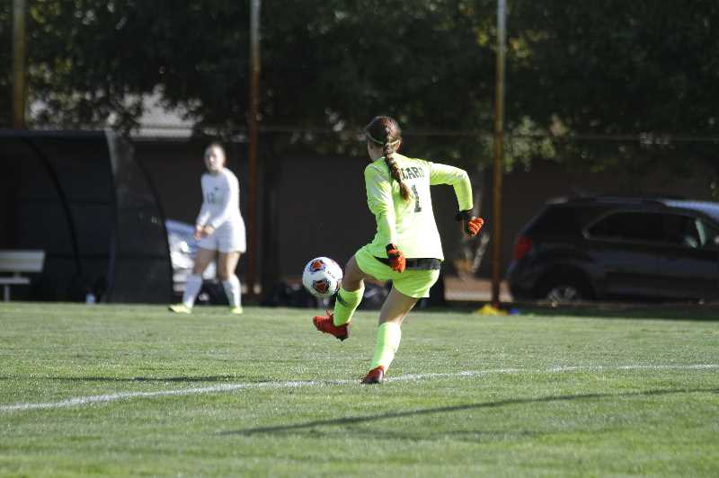 PMG PHOTO: WADE EVANSON - Tigard sophomore goalie Maya Hawks distributes the ball to a defender during the Tigers' nonleague game at Scappoose Tuesday, Sept. 14, at Chinook Park in Scappoose.