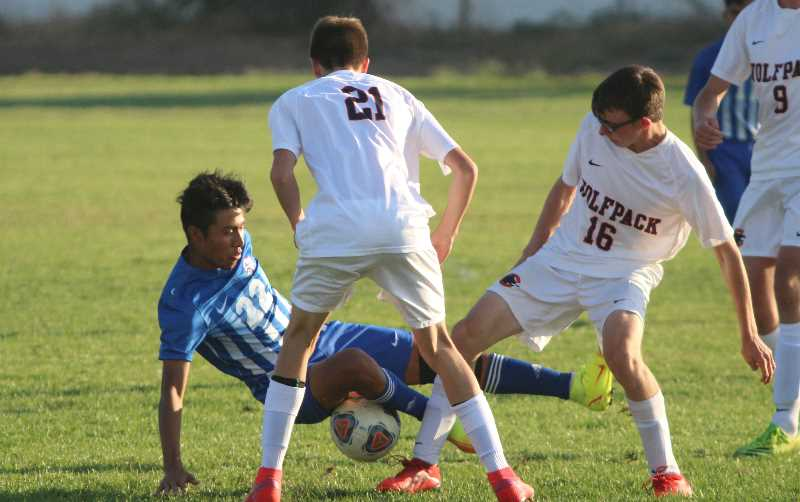 ANDY DIECKHOFF - Madras freshman Eben Tapia (22) was instrumental in the Buffs' attack along the wings.