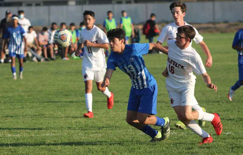 ANDY DIECKHOFF/MADRAS PIONEER - Freshman Steve Gonzalez (13) scored his second goal of the season in the first half against Caldera.