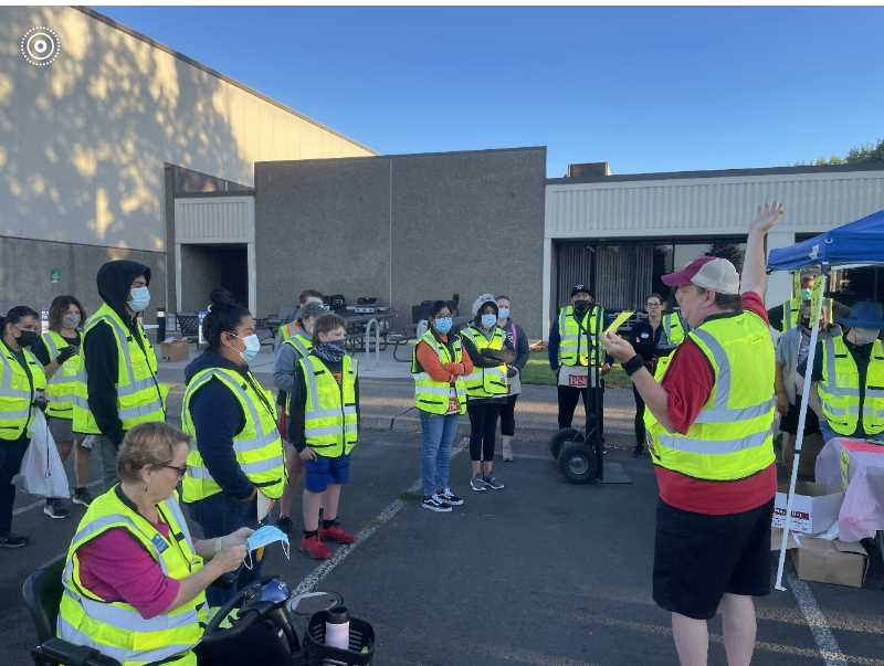 COURTESY PHOTO - Volunteers prepare for the Saturday, Sept. 11, Do It Best Corp. parking lot sale to raise money for the American Cancer Society. This year's annual event was a record breaker, raising $40,700.