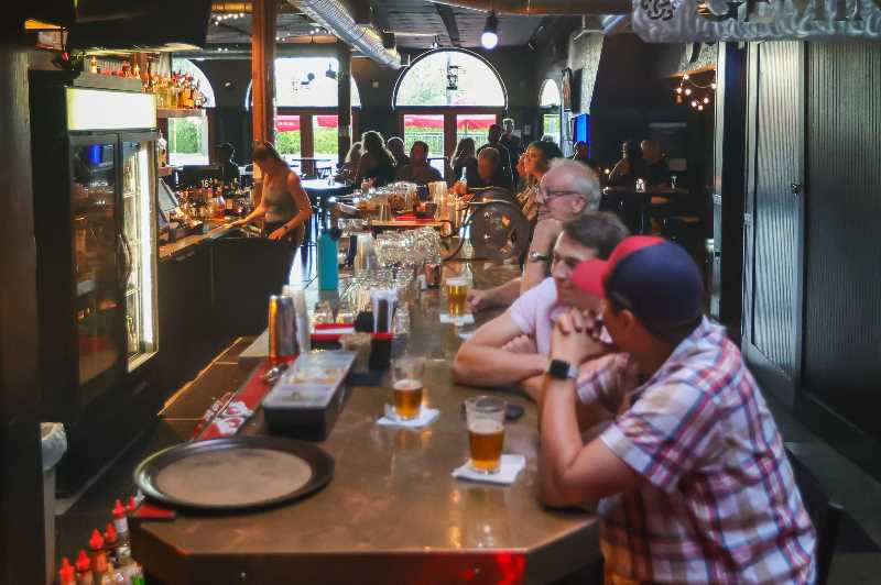 PMG PHOTO: PATRICK MALEE - Lake Oswego's Gemini Bar & Grill reopened earlier in the summer of 2021, but the popular establishment has struggled to hire new employees. Economists say the reason for the high number of job openings is a complex issue.