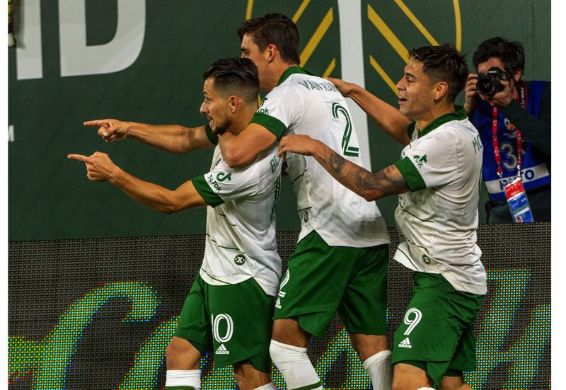 PMG PHOTO: DIEGO G. DIAZ - Felipe Mora (9) and Josecarlos Van Rankin (2) celebrate with Sebastian Blanco after Blanco's stoppage-time goal eatned the Portland Timbers a 2-2 draw with Colorado on Wednesday, Sept. 15 at Providence Park.