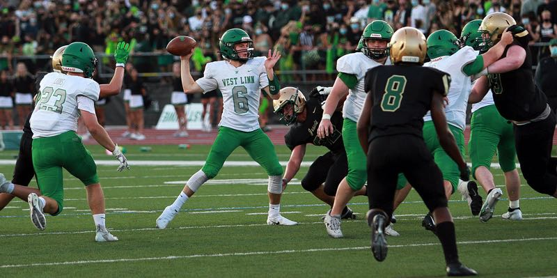 PMG PHOTO: MILES VANCE - West Linn senior quarterback Chase Harmon is quickly proving himself as the Lions chase more success in 2021.
