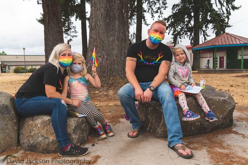 COURTESY PHOTO: DAVID JACKSON - A young family pauses for a photo at Molalla Pride on Sept. 12.