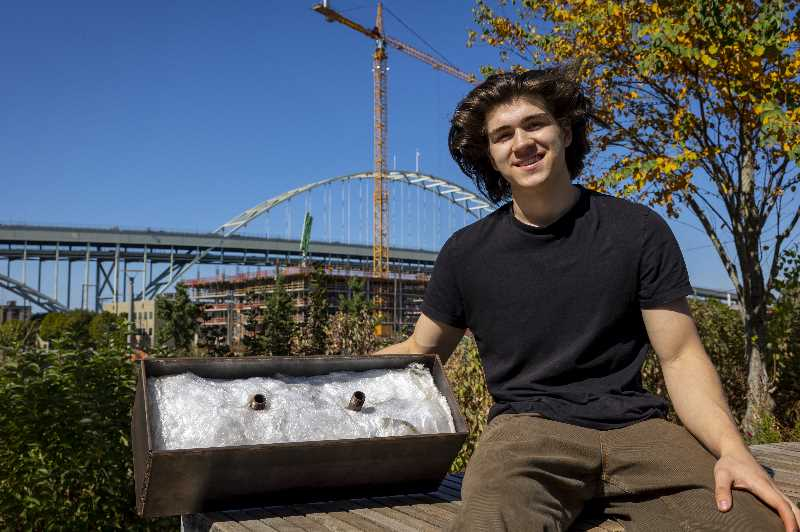 PMG PHOTO: JAIME VALDEZ - Charlie Abrams started the non-profit Recycled Living to build tiny homes for the homeless. He also built the machines for shredding plastic, heating it and molding it into bricks. Here he shows off the form into which the warm plastic is pressed.