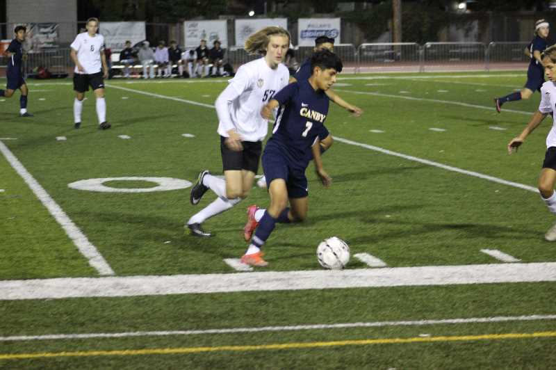 PMG PHOTO: KRISTEN WOHLERS - Canby's Vladmir Bernal Lopez controls the ball at the side.