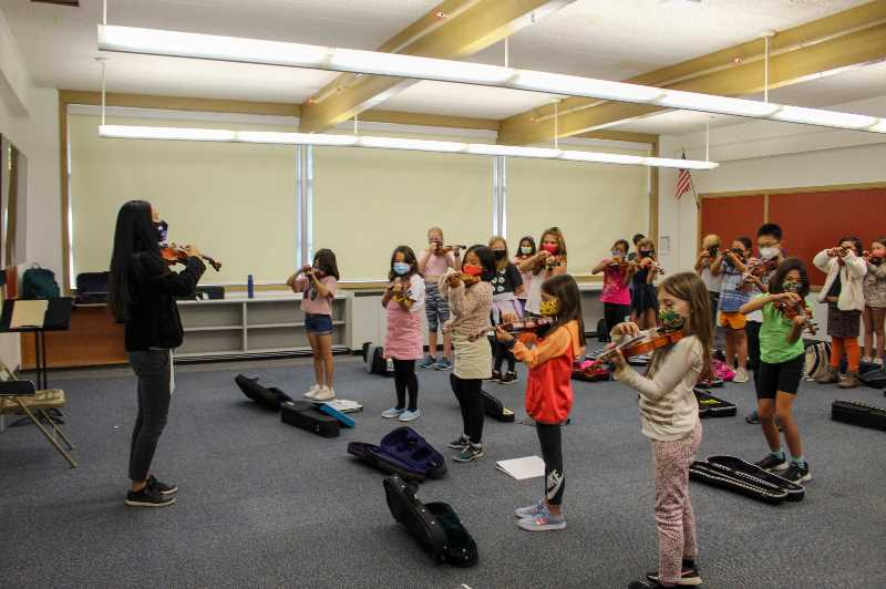 PMG PHOTO: MIA RYDER-MARKS - Eri Nogueira teaches her class introductory strings.