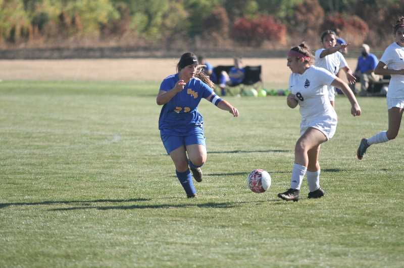 PMG PHOTO: TANNER RUSS - Gervais player Sofia Contreras takes the ball down the field against the visiting Dayton Pirates.