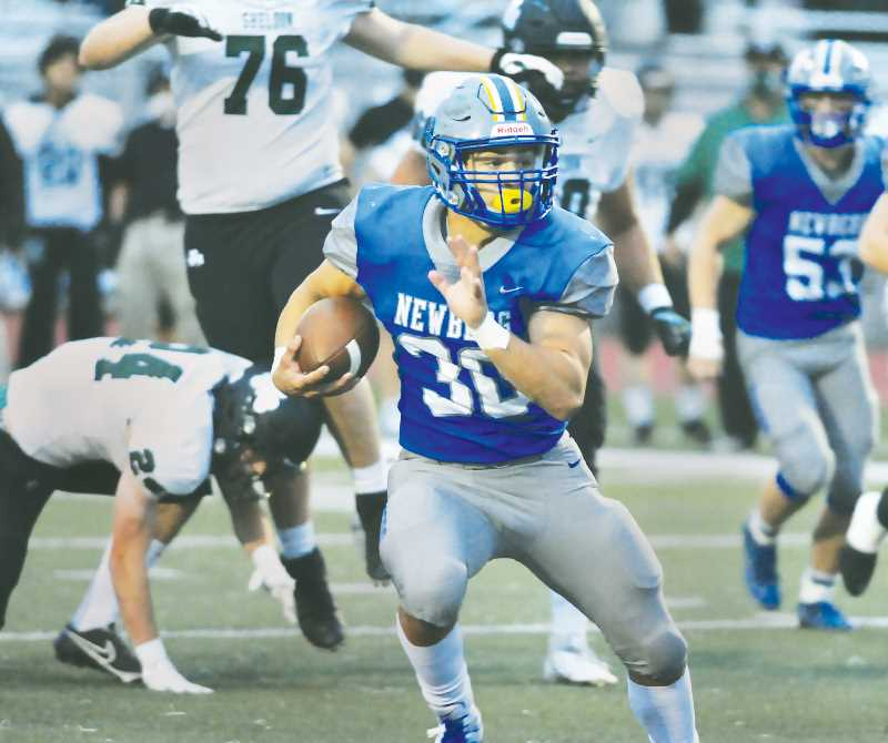PMG PHOTO: GARY ALLEN - Senior running back Price Pothier churns up field during the Tigers 42-28 loss to Sheldon at home on Friday evening.